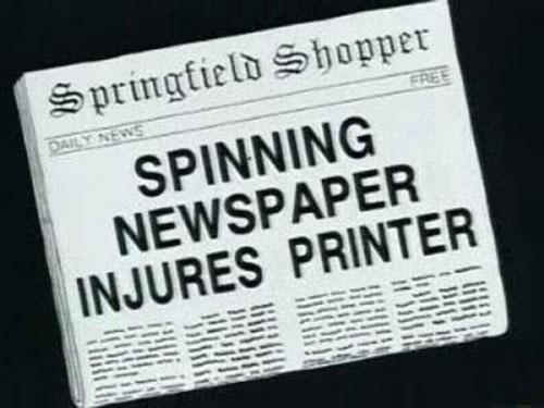 Spinning newspaper injures printer