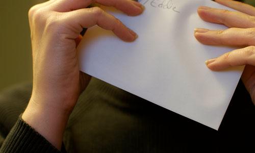 Licking an envelope