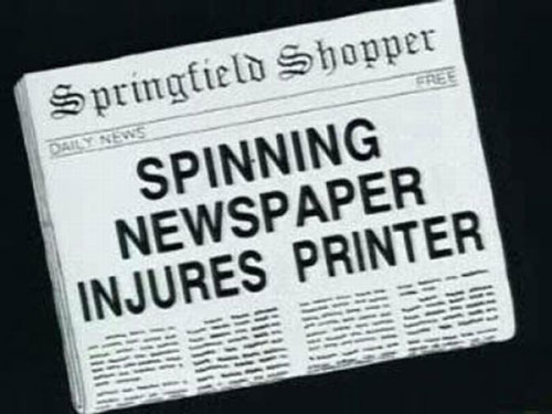 Spinning newspaper injures printer